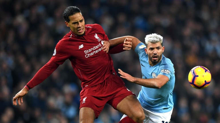 Sergio Aguero of Manchester City is fouled by Virgil van Dijk of Liverpool