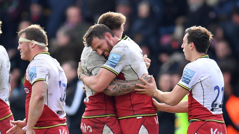 Northampton celebrate their victory at Harlequins in April which swung the top-four battle their way