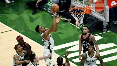 Giannis Antetokounmpo of the Milwaukee Bucks attempts a shot against the Toronto Raptors