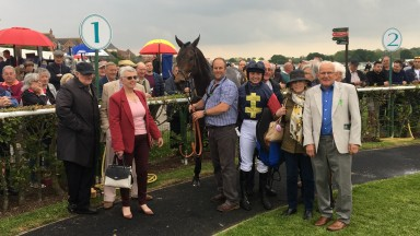 Bryony Frost celebrates with Regulation and owners The Ridgeway Racing For Fun Partnership