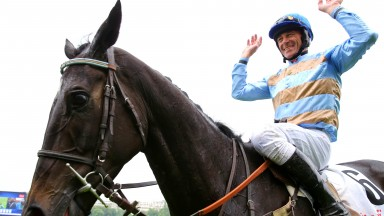Davy Russell celebrates after steering Carriacou to Grand Steep' glory on his very first attempt at the Auteuil chase course