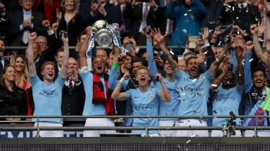 Vincent Kompany of Manchester City lifts the FA Cup trophy