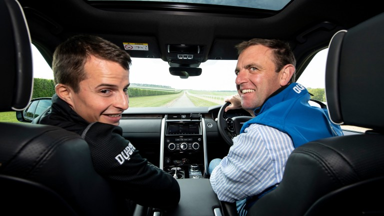 Godolphin trainer Charlie Appleby (right) in his car on the gallops with jockey William Buick