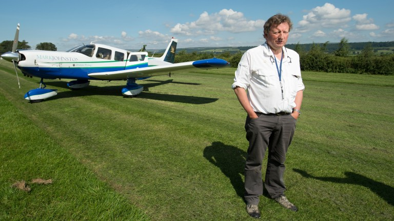 Middleham trainer and registered pilot Mark Johnston with his Cessna aeroplane