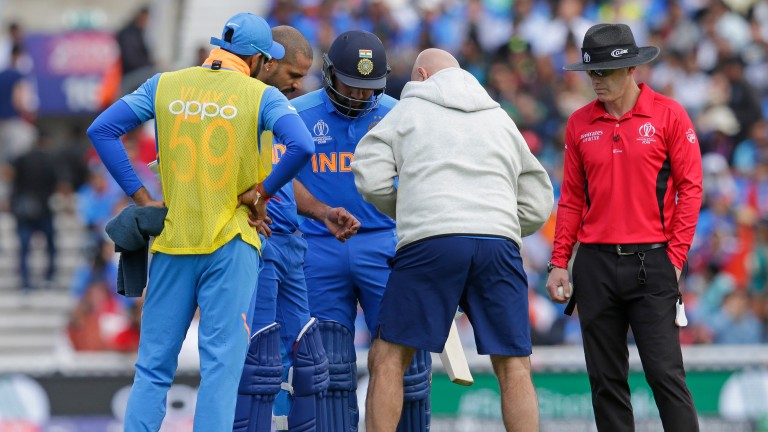 India opener Shikhar Dhawan gets medical attention while batting at The Oval on Sunday