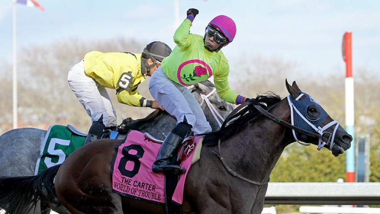 Manny Franco punches the air aboard World Of Trouble after their win in the Grade 1 Carter Handicap