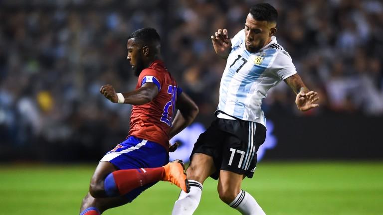Haiti's Duckens Nazon tussles with Argentina's Nicolas Otamendi in a friendly last year