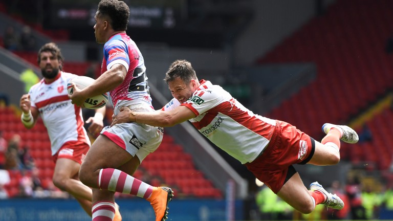 Danny McGuire of Hull HR tackles Salford's Derrell Olpherts