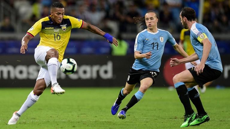 Antonio Valencia of Ecuador in action against Uruguay