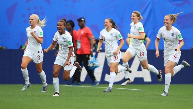 England celebrate their third goal, by Alex Greenwood, against Cameroon at Stade du Hainaut