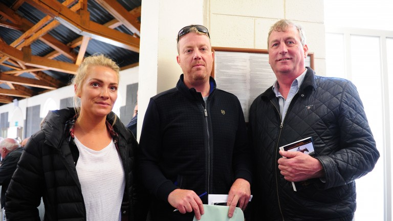 Ellmarie and Paul Holden with Michael Shefflin (centre) after landing the winning bid for Douvan's brother at ?140,000