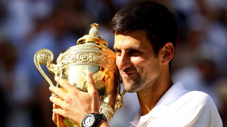 Novak Djokovic has a tight grip on the historic Wimbledon trophy last summer