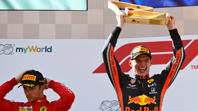 Max Verstappen celebrates after denying Charles Leclerc victory in the Austrian Grand Prix