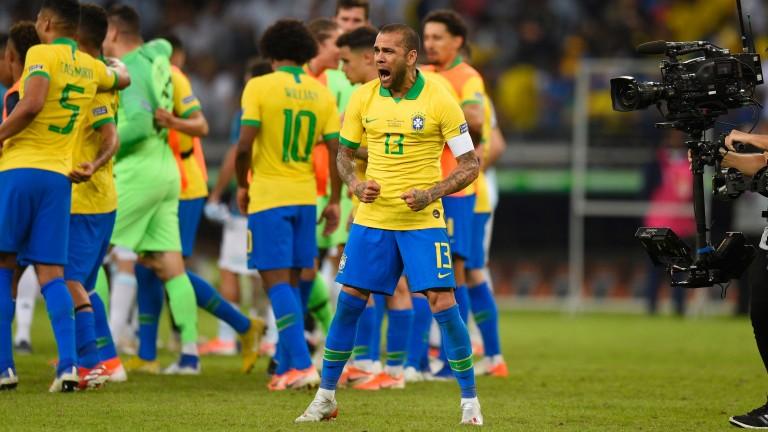 Dani Alves celebrates Brazil winning their Copa America semi-final against Argentina in Belo Horizonte