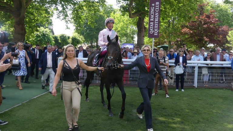 Too Darn Hot returns to the winner's enclosure after victory in the Prix Jean Prat