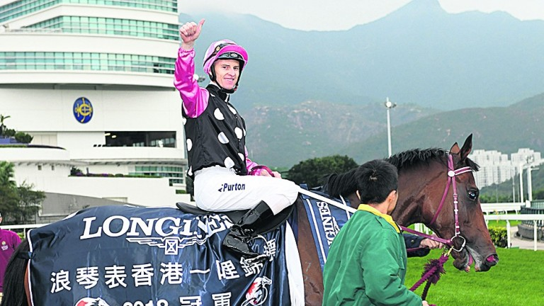 Zac Purton and Beauty Generation after their win in the Longines Hong Kong Mile at Sha Tin