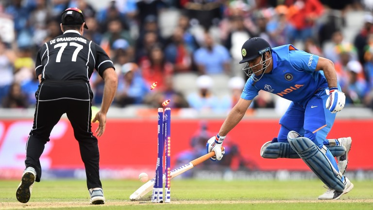 MS Dhoni is run out by Martin Guptill's throw as India slipped to defeat