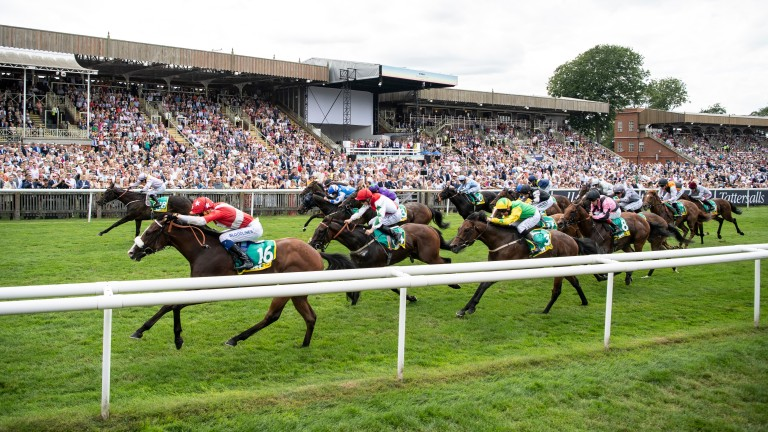 Near and far side have it between them as Pass The Vino (red jacket) and Moss Gill in the bet365 Handicap at Newmarket