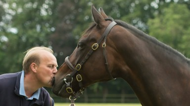 Ed Dunlop is reunited with his wonder mare Ouija Board at Stanley House Stud Newmarket 12.7.16 Pic: Edward Whitaker