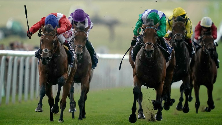 Veracious (red, left) sees off the late charge of One Master to win the Tattersalls Falmouth Stakes