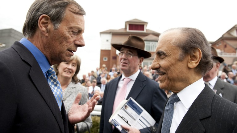 Abdullah (right) speaks to Sir Henry Cecil at Newbury