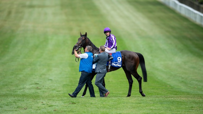 Ten Sovereigns and Ryan Moore after the Darley July Cup