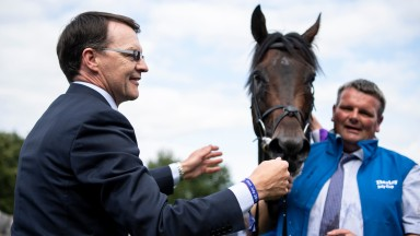 A delighted Aidan O'Brien welcomes back Ten Sovereigns and groom David Hickey after the colt's success in the July Cup at Newmarket