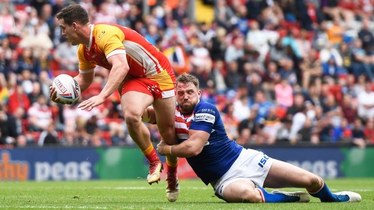 Danny Kirmond of Wakefield brings down Matthew Whitley of Catalan Dragons