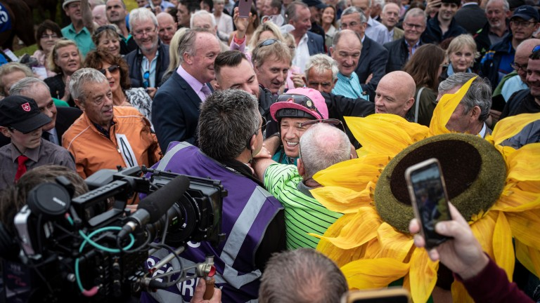 Frankie Dettori is mobbed by fans as he heads out for his first ride at Killarney