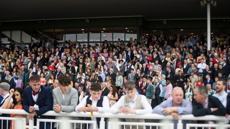 The crowd for the Galway Festival lines the rails at Ballybrit