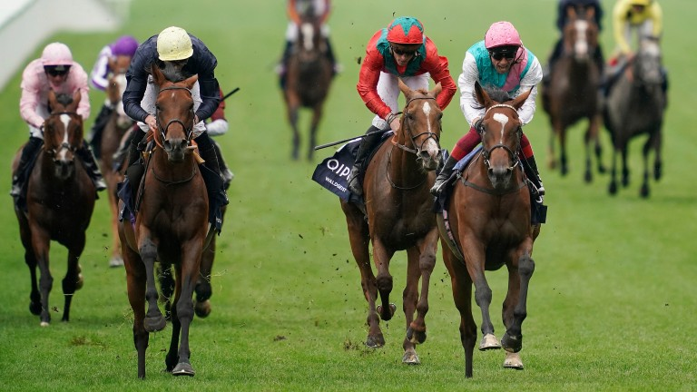 Frankie Dettori riding Enable (pink cap) before winning the King George at Ascot