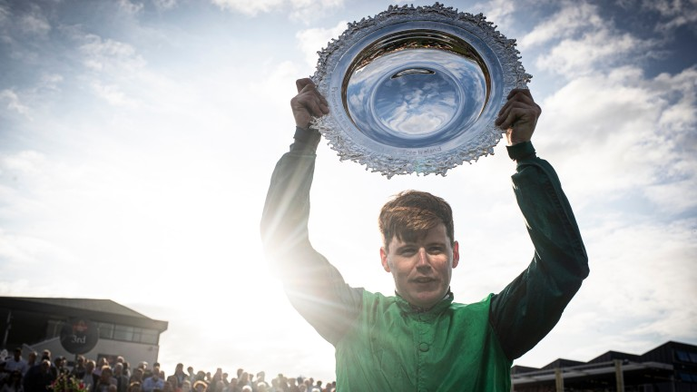 Luke Dempsey holds the Galway Plate trophy aloft following Borice's triumph at Ballybrit