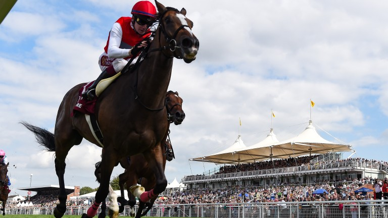 Deirdre flies up the rail to win the Nassau Stakes for Japan