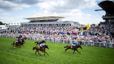 Battaash (Jim Crowley) beats the former Australian-trained Group winner Houtzen readily for a third successive win in the King George Qatar Stakes at Goodwood