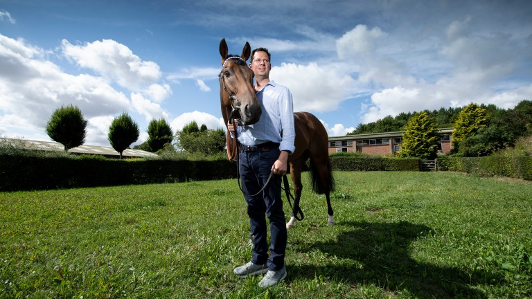 Battaash and Charlie Hills enjoy a relaxing moment in the sunshine at home