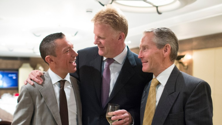 Frankie Dettori with his manager Peter Burrell (centre) and agent Ray Cochrane