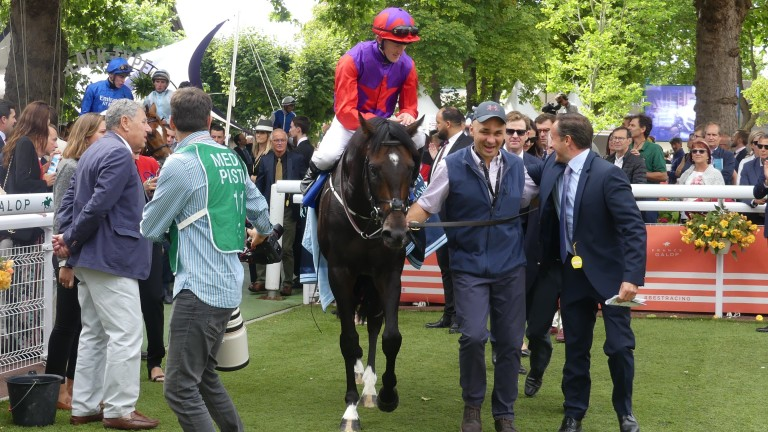 Romanised and Billy Lee return to the Deauville winner's enclosure after landing the Prix Jacques le Marois