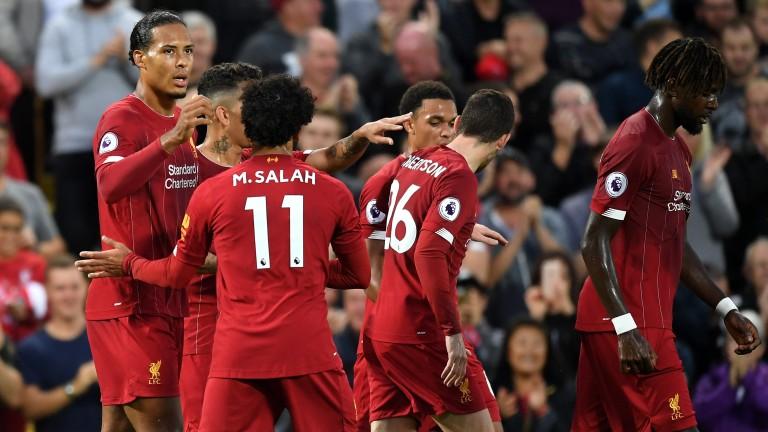 Liverpool celebrate Virgil van Dijk's goal in their 4-1 win over Norwich on Friday
