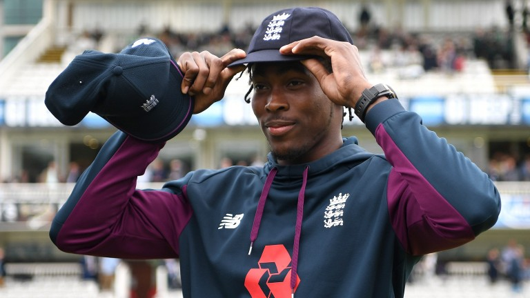 Fast bowler Jofra Archer tries on his England Test cap at Lord's