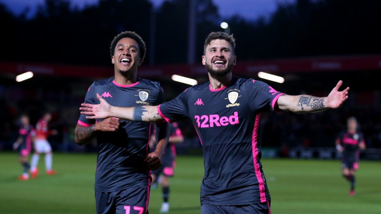 Mateusz Klich (right) and Helder Costa helped Leeds ease past Salford in the EFL Cup