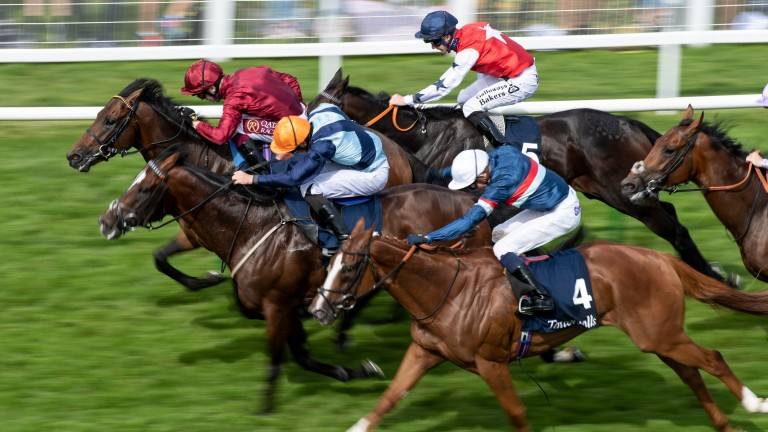 Accidental Agent (Charlie Bishop, orange cap) just fails to catch Kick On (Oisin Murphy) in the Sovereign Stakes at Salisbury
