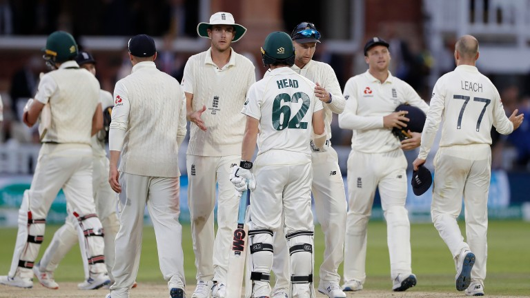 England fielders and the not out Australian batsmen shake hands when the Lord's Test ended as a draw