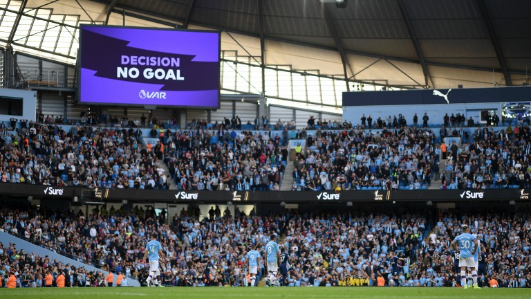The big screen shows the VAR decision of 'No Goal' for Manchester City