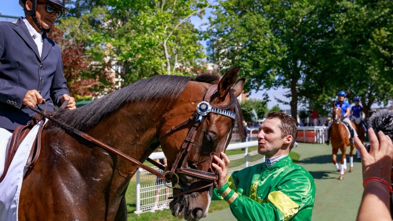 Friends reunited: Jockey Stephane Pasquier greets Signs Of Blessing and dressage rider Robert Danloux during the Au Dela Des Pistes parade of champions at Deauville