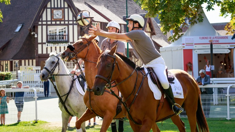 Retrained thorougbreds taking part in a Horse Ball demonstration during the Au Dela Des Pistes charity day at Deauville
