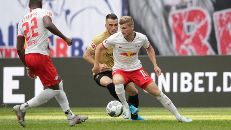 Timo Werner of RB Leipzig battles for possession with Filip Kostic of Eintracht Frankfurt