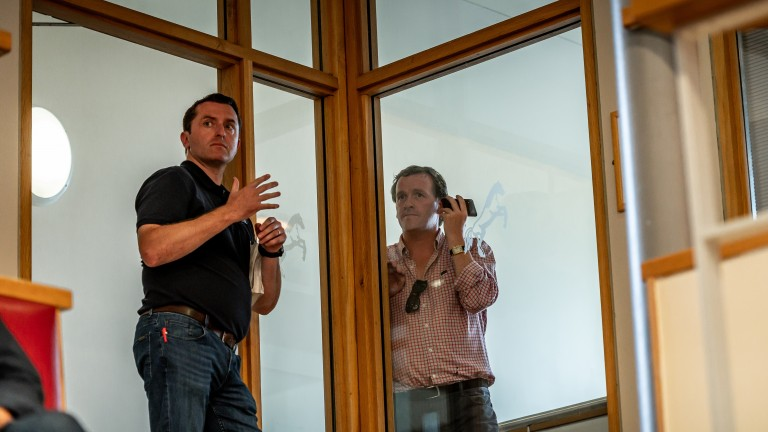 Gimme five: Ross Doyle (left) signals a bid as Richard Hannon looks on