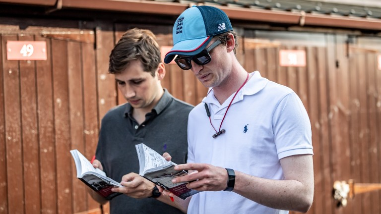Eyes down: Archie Watson (cap) and Blandford Bloodstock's Tom Biggs study catalogue