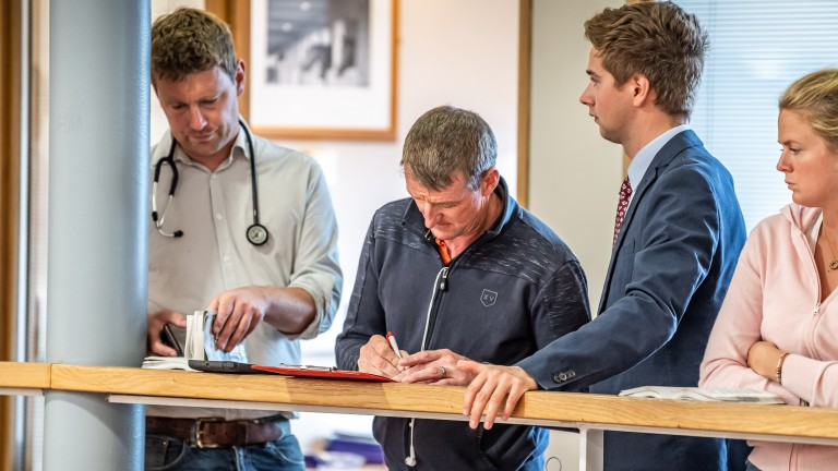 Mick Murphy of Longways Stables signs the docket for the £170,000 Muhaarar filly out of Fig Roll