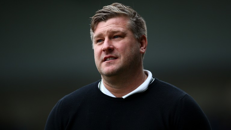 Karl Robinson is a manager whose teams tend to gain an even larger sharer of corners in their games